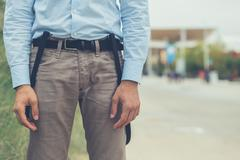 Detail of a young man posing in an urban context - stock photo
