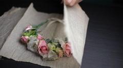Girl packs flower Stock Footage