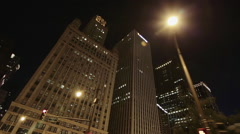 Nighttime panning shot from car of Chicago's skyline Stock Footage
