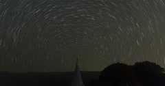 View of asian buddhist pagoda and startrail in galaxy universe (time lapse) Stock Footage