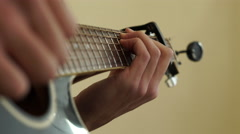 4K close up of Guitar neck caucasian fingers playing black guitar Stock Footage