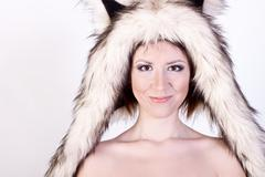 Beautiful girl dog hat, smiling happy, joke winter naked woman with gentle make Stock Photos