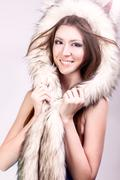 Beautiful girl dog hat, smiling happy, joke winter naked woman with gentle make Stock Photos