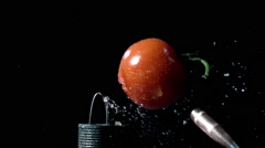 Slow motion of 50 cal. bullet hitting tomato from airgun. Stock Footage