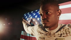 African American male with American flag in hands - stock footage