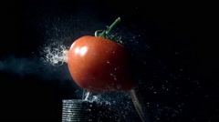 Slow motion of 50 cal. bullet hitting tomato Stock Footage