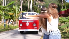 Travel Hippie Girls Hitchhiking Red Minivan on Road Stock Footage