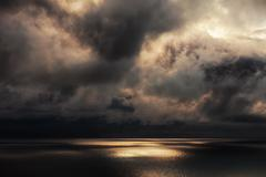Sun beams on the sea Stock Photos