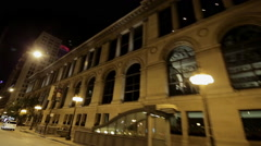 Nighttime panning shot from car of Chicago's skyline - stock footage