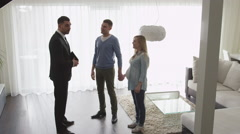 Real-estate Agent Shows New Apartments to Couple. Handshake Concept. Stock Footage