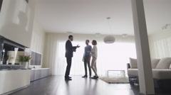 Real-estate Agent Shows New Apartments to Couple. Woman is Pregnant. - stock footage