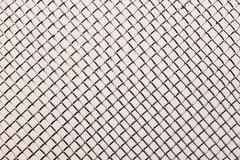 metal grid close up on a wight background - stock photo