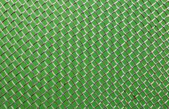 metal grid close up on a green background - stock photo