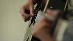 4K Close up focused caucasian hands fingering / playing Guitar Stock Footage