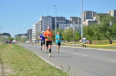 Blurry Runners on City Race - stock photo