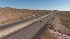 An aerial shot of semi truck on highway in the vast desert - stock footage