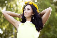 Beautiful brunette woman fashion style outdoors in yellow dress smiling happy Stock Photos