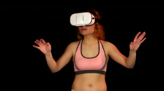 Amazed young woman looking around in the virtual reality headset - stock footage