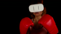 Female in the red boxing gloves invite to play in virtual reality video game - stock footage