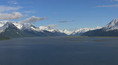Panning shot of lake and mountains in Alaska Stock Footage