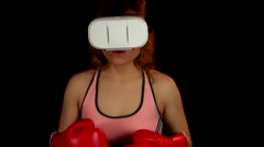 Female boxer invite to play in video game with virtual reality headset - stock footage