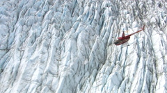Helicopter flying over glacier in Alaska Stock Footage