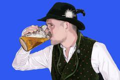 illustration of bavarian man drinking beer - stock illustration
