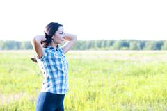 Girl in plaid shirt summer  meadow, concept the idea of happiness brunette rest - stock photo