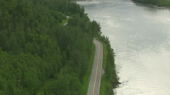 Aerial shot curvy road and forest, Alaska Stock Footage