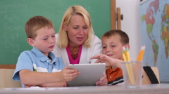 Teacher at school uses digital tablet in classroom - stock footage