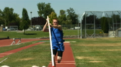 Athlete running in pole vault, super slow motion Stock Footage