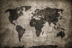 Retro world map on concrete, plaster wall. Vintage, grunge background. - stock photo