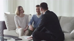 Happy Family Signing Contract with Real-estate Agent. Stock Footage