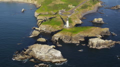 Aerial view of lighthouse on coastline Stock Footage