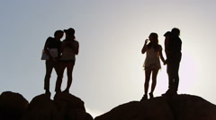 Group of young people on road trip climb rocks Stock Footage