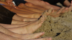 Feet in the sand Stock Footage