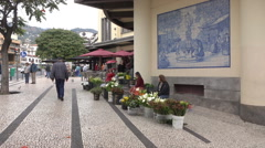 Women sell flowers outside Funchal Workers Market, Madeira, Portugal Stock Footage