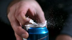 Slow motion of aluminium can opening and spraying as tab is being pulled. - stock footage