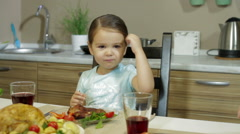 A Little girl having family dinner Stock Footage
