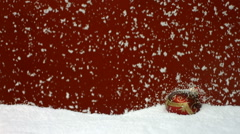 Snow falling on Christmas ornament, slow motion Stock Footage