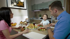 Young Family having a dinner together Stock Footage