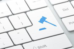 Law concept: Gavel on computer keyboard background - stock illustration