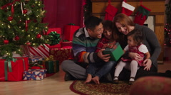 Family passing out presents Stock Footage