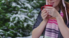 Woman with mug of cocoa in winter Stock Footage