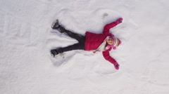 Girl playing in the snow Stock Footage