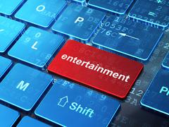 Entertainment, concept: Entertainment on computer keyboard background - stock illustration