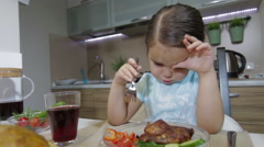 Sad Little girl having family dinner Stock Footage