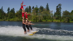 Stunt water skiers form human pyramid Stock Footage