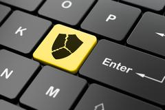 Protection concept: Broken Shield on computer keyboard background - stock illustration