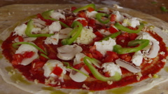 Putting toppings on pizza Stock Footage